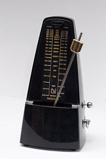 Metronome device that produces an audible click or other sound at a regular interval
