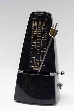 Nikko brand mechanical metronome in motion.