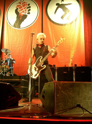 Green Day: Rock Band - Image: Mike Dirnt and Tré Cool performing at Cardiff