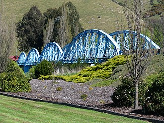 Millers Flat - The heritage-listed Millers Flat Bridge, a four span steel truss bridge which crosses the Clutha River.