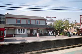 Mineola station (LIRR) - Mineola station, where a long-standing sign company welcomes commuters to the village of Mineola.