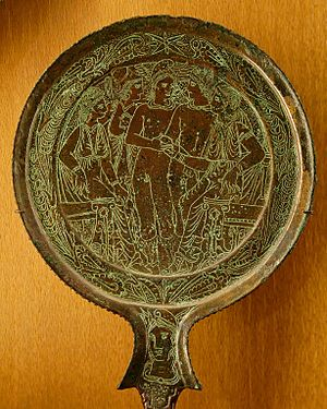 The Golden Bough - The Judgement of Paris—an Etruscan bronze-handled mirror of the fourth or third century BC that relates the often misunderstood myth as interpreted by Frazer, showing the three goddesses giving their apple or pomegranate to the new king, who must kill the old king - Campana Collection, Greek, Etruscan and Roman Antiquities, Sully