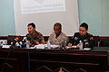 Mongolian Armed Forces Lt. Col. J. Molorbold, left, the chief of Peace and Support Operations Division G3, answers a question as U.S. Marine Corps Col. Hector Velez, center, the U.S. director for Khaan Quest 130801-M-MG222-004.jpg