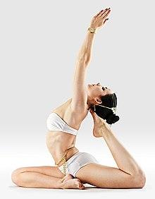 220px Mr yoga one legged king pigeon 1  %281%29 yoga asanas Liste des exercices et position à pratiquer
