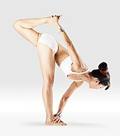 Mr-yoga-twisting one legged forward bend.jpg