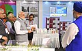 "Narendra Modi visiting an exhibition on Flagship Missions of Urban Development during the event ""Transforming Urban Landscape Third Anniversary of Pradhan Mantri Awas Yojana (Urban) (1).JPG"