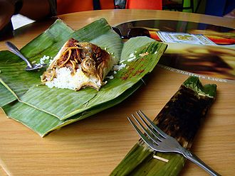 Nasi lemak - Nasi lemak are traditionally wrapped in banana leaves, served in Singapore.