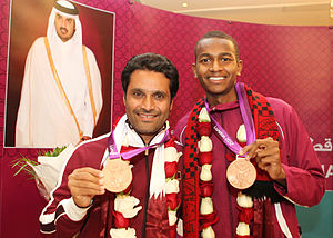 Sport in Qatar - Qatar's two bronze medalists at the 2012 Summer Olympics, Nasser Al-Attiyah and Mutaz Essa Barshim posing for a picture.