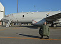 Naval Aircrewman attached to Patrol Squadron (VP) 16 watch the exterior of a P-8A Poseidon during a high-frequency radio check before a mission to assist 140320-N-XY761-022.jpg