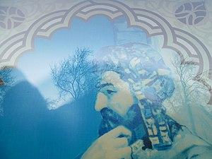 Izzeddin Hasanoglu - Image: Nizami adına Ədəbiyyat Muzeyinin binasının pəncərəsində İzzəddin Həsənoğlu rəsmi (1)