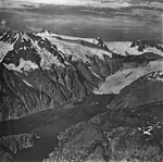 Northwestern Glacier, terminus of tidewater glacier, mountain glaciers with bergschrund and icefall, September 4, 1977 (GLACIERS 6703).jpg