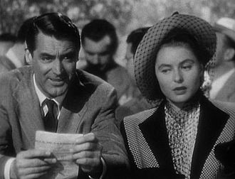 Notorious (1946 film) - Devlin and Alicia meet at the track, with Sebastian watching from the grandstand.