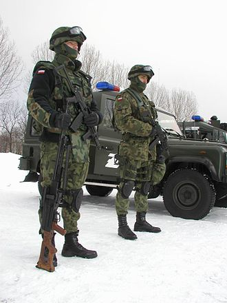 Law enforcement agency - Two military police officers and a four-wheel drive police car from the Żandarmeria Wojskowa (Poland)
