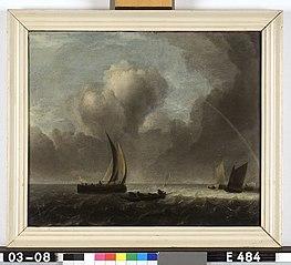 Schepen voor de kust in een stevige wind