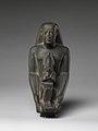 Padiamunrenebwaset, son of Irethoreru, holding a seated statue of Osiris MET DP245119.jpg