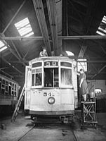Painting the roof and washing the windows of a 1912 trolley 8d15856v.jpg