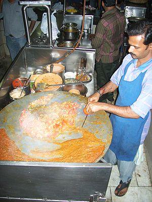 Pav bhaji - Pav bhaji being prepared on an iron tava