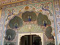 Peacock gate- the city place is worth a trip jaut to see some amazing mosaic work. the peacock gate.in particular. a pride of peacock an ornate doorway.palace.retainers stand at atteention as in the past when - panoramio.jpg