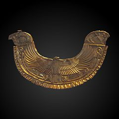 golden Egyptian-style pectoral ornated with royal falcons