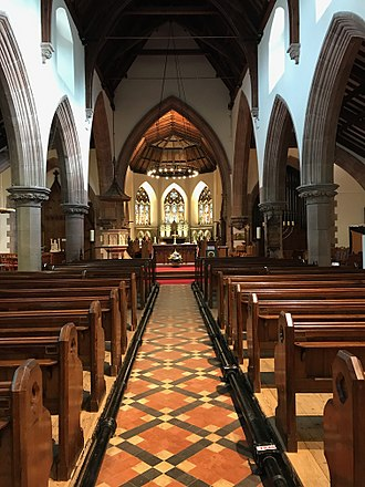 Peel Cathedral - The nave of St German's Cathedral, Peel, Isle of Man, looking towards the nave altar and, beyond it, the choir, chancel, and high altar.