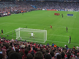 Penalty shoot-out (association football) - Philipp Lahm is about to score in the 2012 UEFA Champions League Final