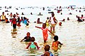 People of various ages swimming at the Coco beach shores celebrating New Year's Day at Dar-es-salaam, Tanzania (2019).jpg