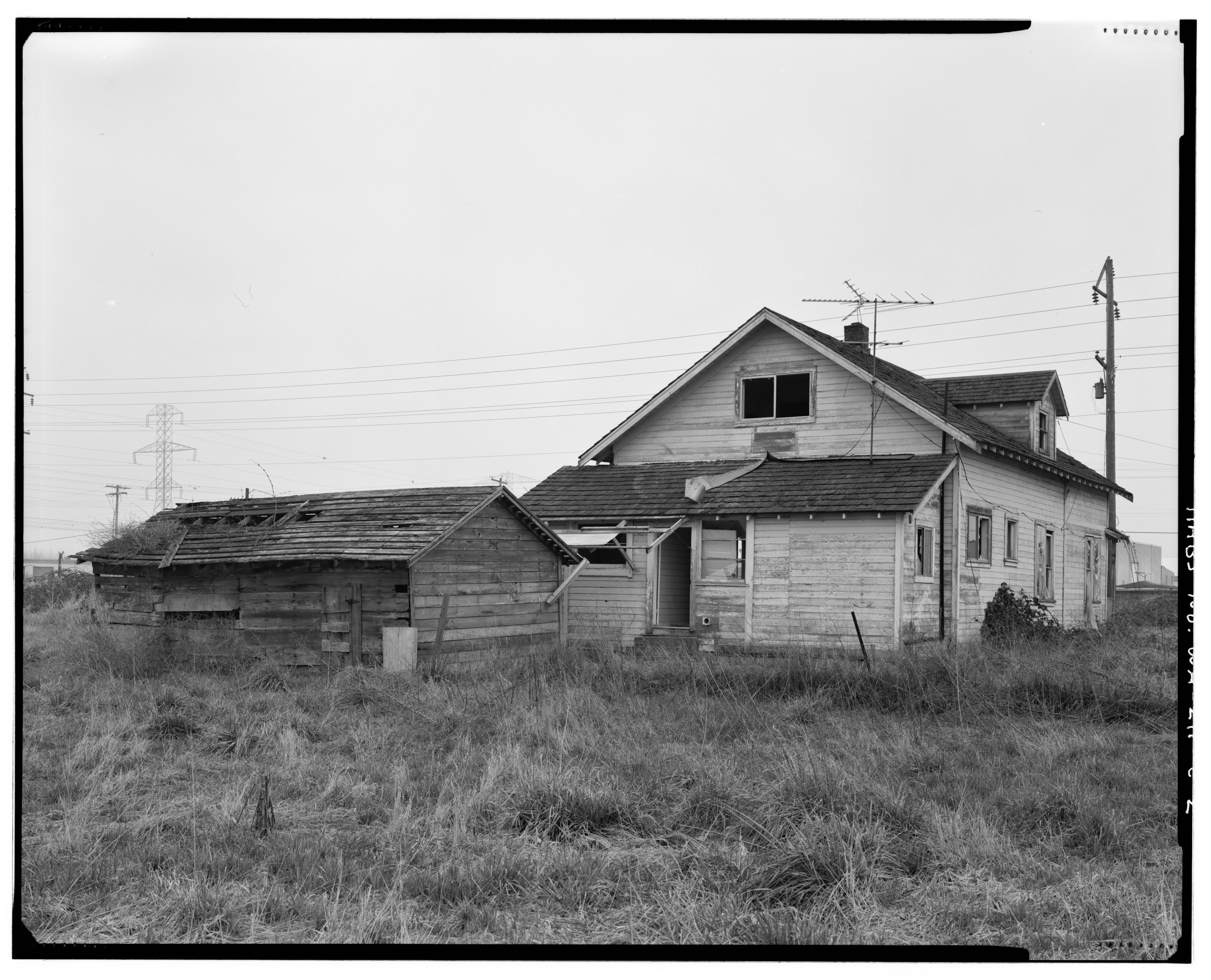 File Perspective view of SW corner of farmhouse shed includes rear of farmhou
