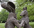 Pink Lady-Hare dancing with big brown dog 1 (3572344537).jpg