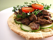 Pita topped with artichoke hummus and lamb.jpg