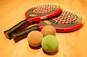 Platform tennis - Paddles and balls used in playing platform tennis