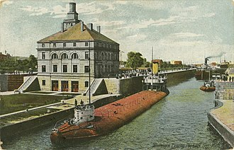 Whaleback - A whaleback traversing the Poe Lock, ca. 1910, showing how low a laden boat rides