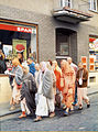Prabhupada on a morning walk with the disciples in Germany.jpg