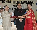 Pranab Mukherjee presenting the Rajat Kamal Award for Best Supporting Actress (Shared) Astu (Marathi) to Ms. Amruta Subhash, at the 61st National Film Awards function, in New Delhi. The Secretary.jpg