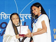 Pratibha Devisingh Patil presenting the Rajat Kamal Award to Ms. Mitalee Jagtap-Varadkar for the Best Actress (Baboo Band Baaja), at the 58th National Film Awards function, in New Delhi on September 09, 2011.jpg