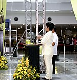 President Gloria Macapagal-Arroyo applauds after she spearheaded the installation of the bust of the country's fallen hero, former Senator Benigno Aquino Jr. on the occasion of his 25th year death anniversary.jpg