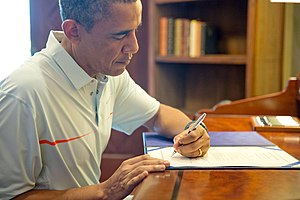 Bipartisan Budget Act of 2013 - Image: President Obama signing the Bipartisan Budget Act of 2013