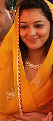 Priyadarshini Raje Scindia wearing a golden-yellow sari.