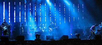 Christgau's tepid response to English rock band Radiohead (pictured in 2004) was a source of controversy. Radiohead Coachella 2004 cropped.jpg