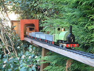 16 mm scale - Much modified Mamod live steam locomotive and train on a garden railway layout