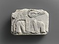 Relief plaque, upper part of crocodile-headed god MET DP236820.jpg