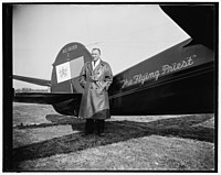 Rev. Paul Schulte (with airplane) LCCN2016876546.jpg