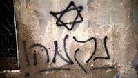 Revenge graffiti on the burned Dawabsheh house.jpg