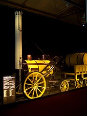 Small, bright yellow, steam locomotive