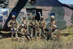 Soldier - South African soldiers next to a helicopter