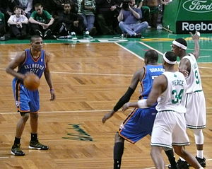 Russell Westbrook - Westbrook (left) looks at then-teammate Kevin Durant in the post against Boston in 2010.