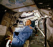 STS-5 Overmyer behind pilot's seat