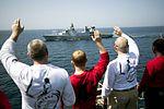 Sailors wave to the Danish frigate as it departs the Arabian Gulf. (34402694941).jpg
