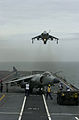 Sea Harrier FA2 801 NAS hovers over HMS Illustrious (R06) 2001.jpeg