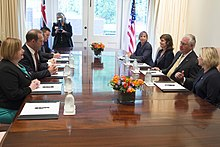 Little (as Labour leader) sitting with other politicians and officials on the left of the table, with US Secretary of State Rex Tillerson and other officials on the right of the table