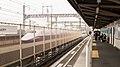 Shinkansen E2 seen from Yoshinohara Station on the New Shuttle 20160328.jpg